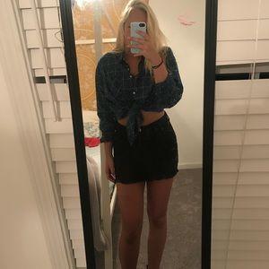 Distressed black mini skirt